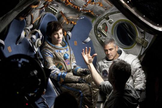 Na planie filmowym - Sandra Bullock i George Clooney oraz reżyser Alfonso Cuaron